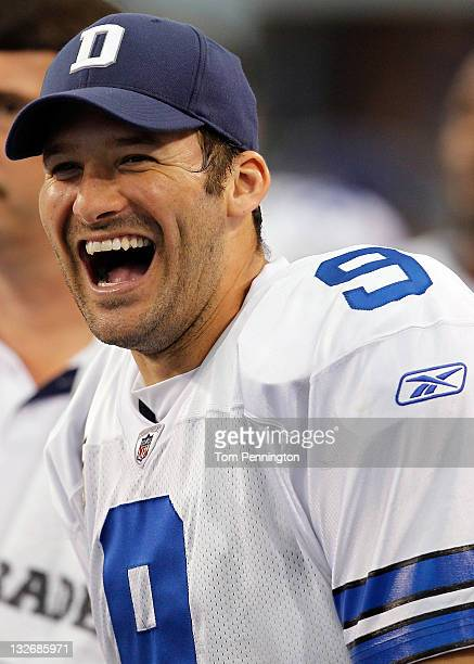 Tony Romo of the Dallas Cowboys celebrates on the sidelines in the final seconds of the game against the Buffalo Bills at Cowboys Stadium on November...