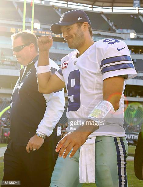 Tony Romo of the Dallas Cowboys celebrates the win as he walks off the field after the game against the Philadelphia Eagles on October 20, 2013 at...
