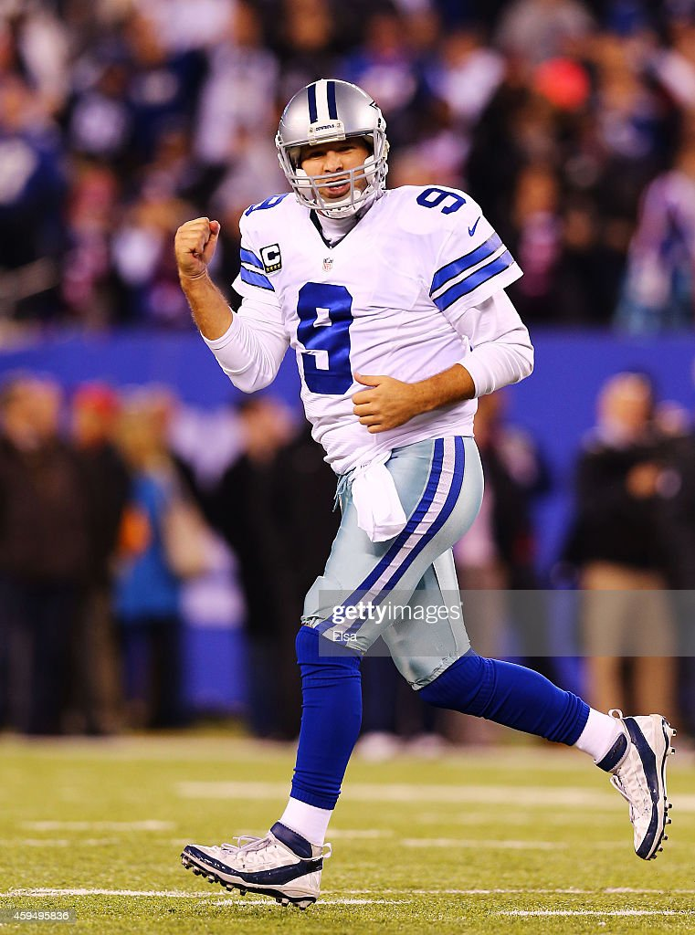 Tony Romo #9 of the Dallas Cowboys celebrates throwing the game winning touchdown pass in the fourth quarter against the New York Giants at MetLife Stadium on November 23, 2014 in East Rutherford, New Jersey. The Cowboys defeated the Giants 31 to 28.