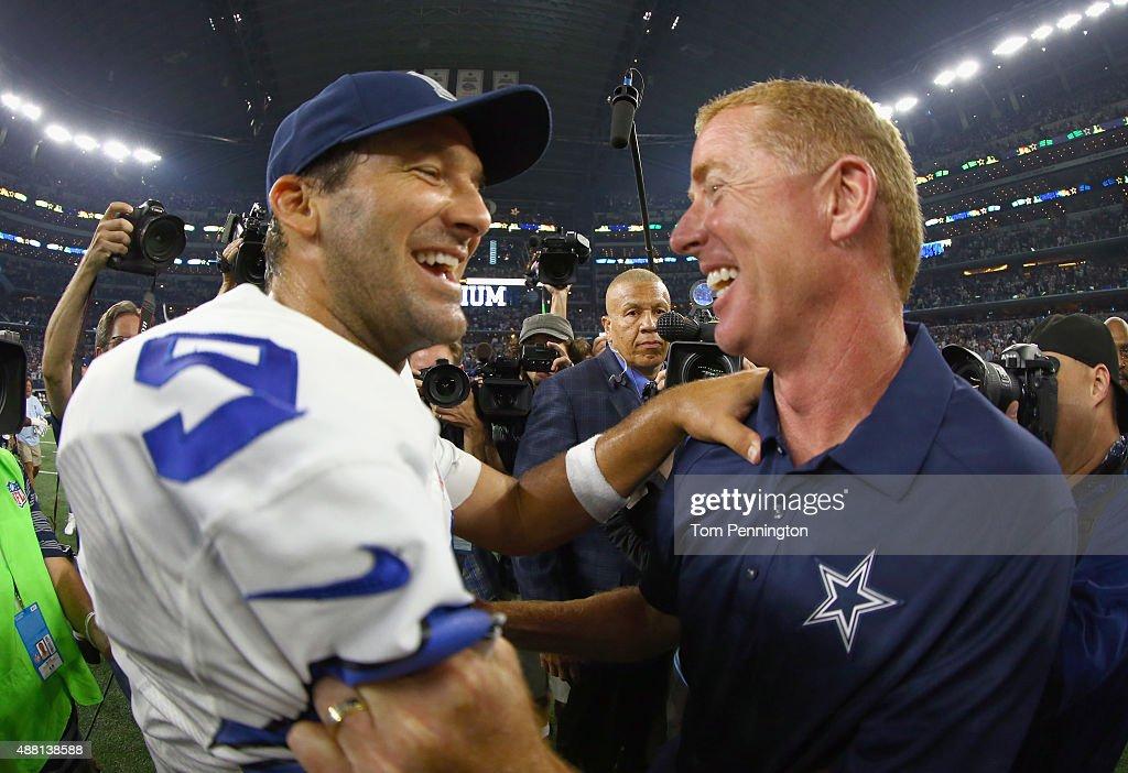 Tony Romo #9 of the Dallas Cowboys celebrates with head coach Jason Garrett of the Dallas Cowboys after the Dallas Cowboys beat the New York Giants 27-26 at AT&T Stadium on September 13, 2015 in Arlington, Texas.