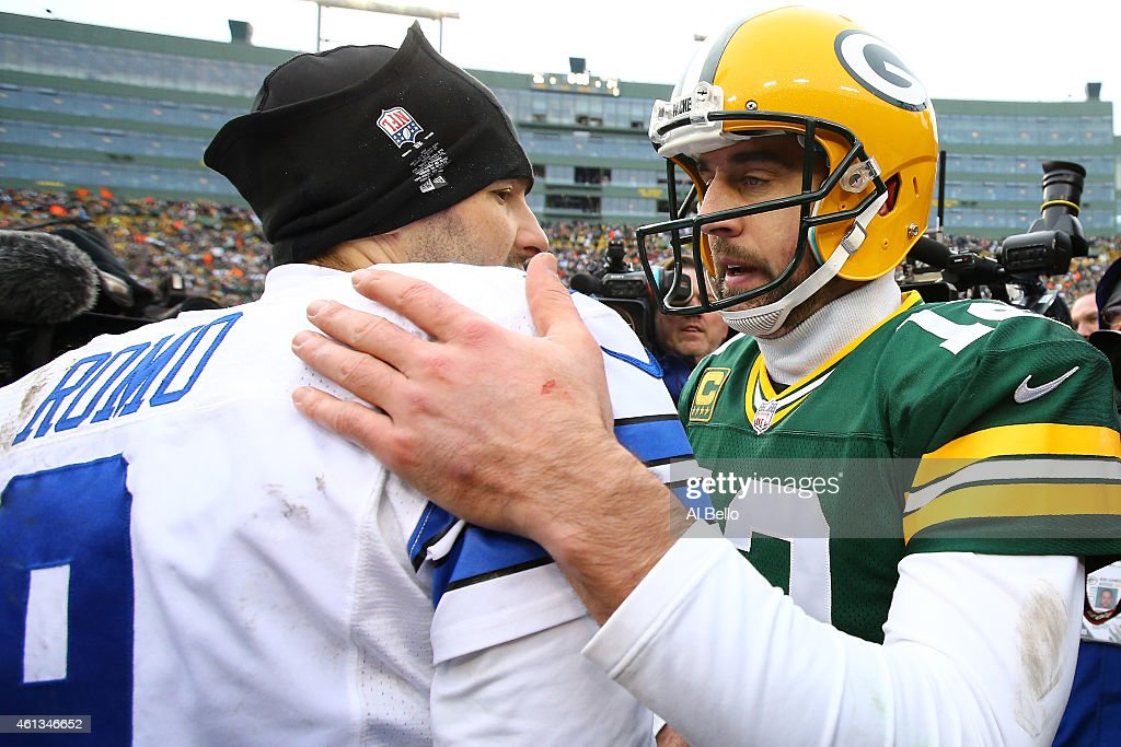 Tony Romo #9 of the Dallas Cowboys congratulates Aaron Rodgers #12 of the Green Bay Packers after the 2015 NFC Divisional Playoff game at Lambeau Field on January 11, 2015 in Green Bay, Wisconsin. The Packers defeated the Cowboys 26-21.