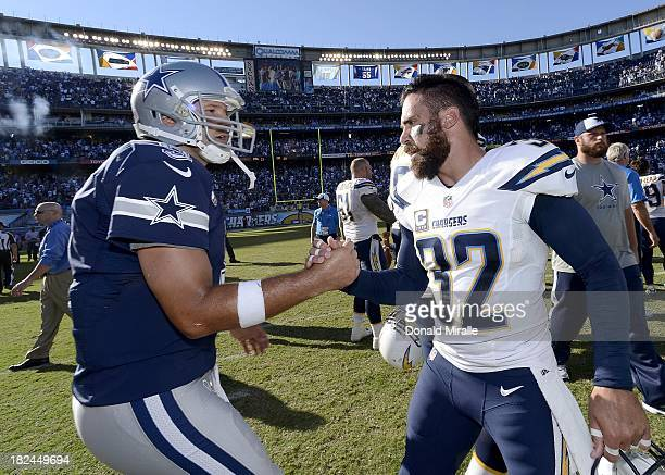 Tony Romo of the Dallas Cowboys congratulates Eric Weddle of the San Diego Chargers on September 29 2013 at Qualcomm Stadium in San Diego California