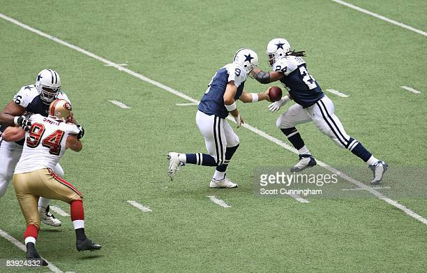 Tony Romo of the Dallas Cowboys hands off to Marion Barber during the game against the San Francisco 49ers at Texas Stadium on November 23 2008 in...