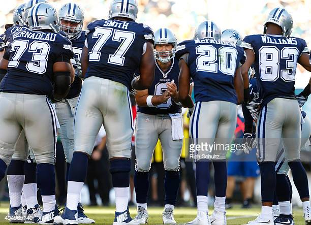 Tony Romo of the Dallas Cowboys huddles with his offense during a football game against the Philadelphia Eagles at Lincoln Financial Field on...
