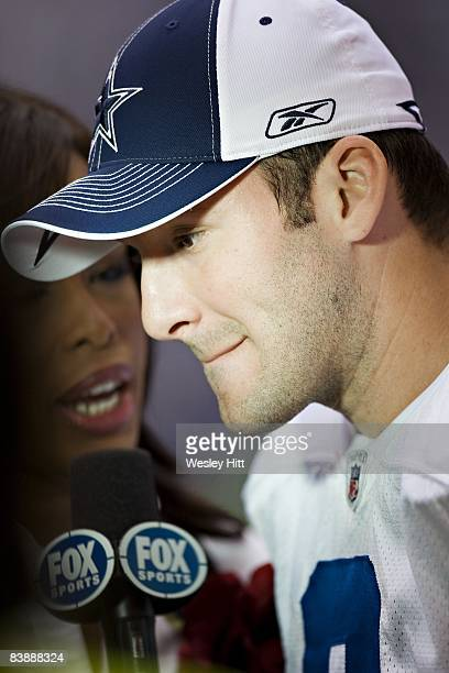 Tony Romo of the Dallas Cowboys is interviewed by FOX Sports after a game against the Seattle Seahawks at Texas Stadium on November 27 2008 in Irving...