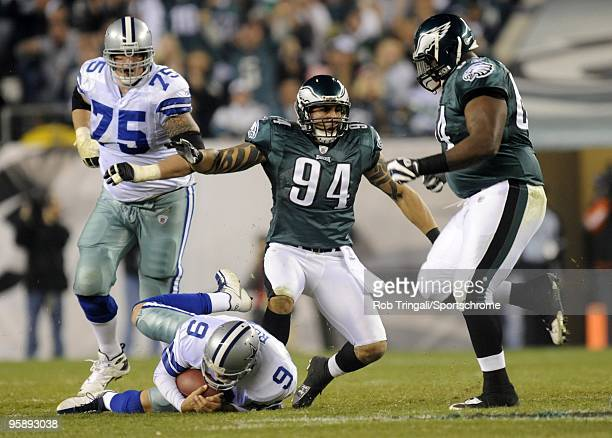 Tony Romo of the Dallas Cowboys is sacked by Jason Babin of the Philadelphia Eagles at Lincoln Financial Field on November 8 2009 in Philadelphia...