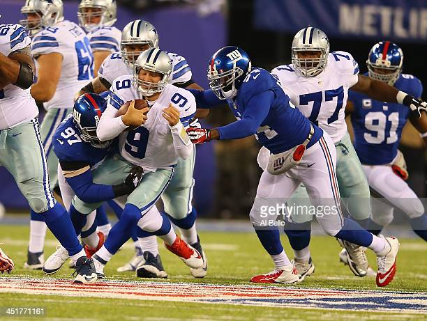 Tony Romo of the Dallas Cowboys is sacked by Linval Joseph and Spencer Paysinger of the New York Giants during their game at MetLife Stadium on...