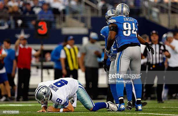 Tony Romo of the Dallas Cowboys lays on the turf after being sacked by Ezekiel Ansah of the Detroit Lions during the first half of their NFC Wild...