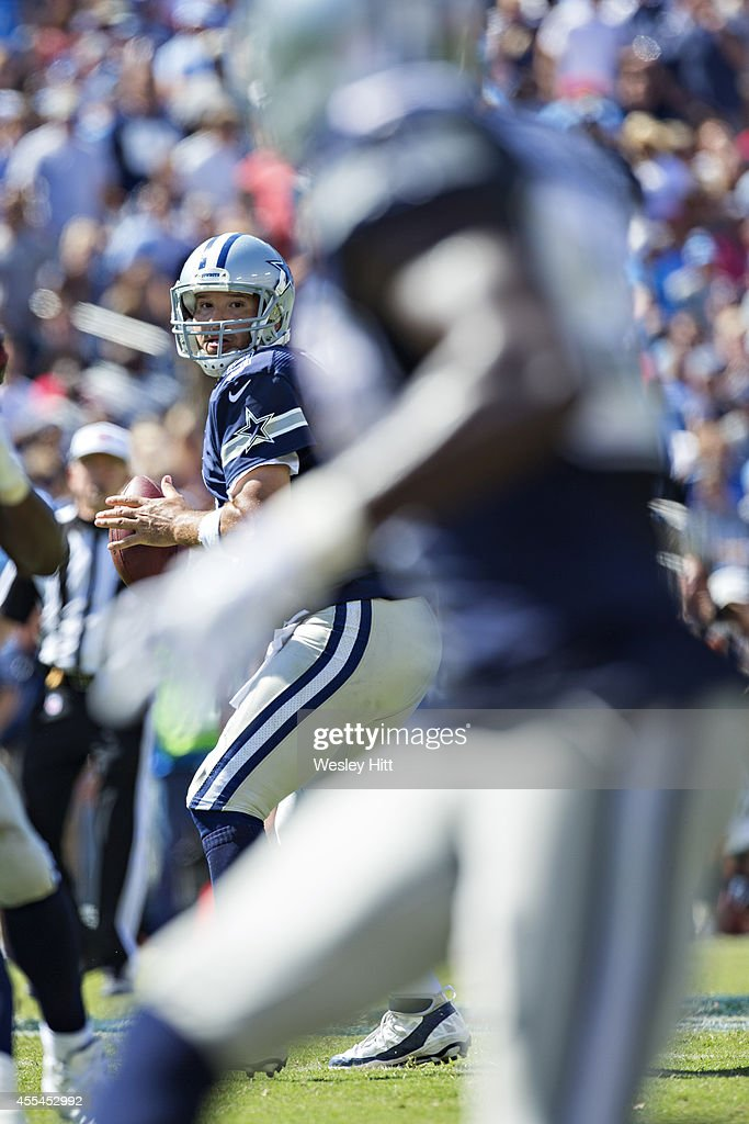 Tony Romo #9 of the Dallas Cowboys looks downfield for a receiver during a game against the Tennessee Titans at LP Field on September 14, 2014 in Nashville, Tennessee. The Cowboys defeated the Titans 26-10.