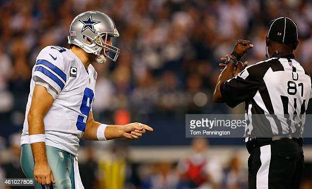 Tony Romo of the Dallas Cowboys reacts after a penalty is called against the Cowboys during the second half of their NFC Wild Card Playoff game...