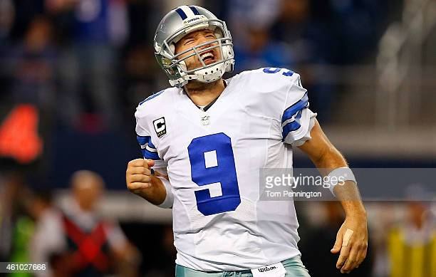 Tony Romo of the Dallas Cowboys reacts after the Cowboys score against the Detroit Lions during the second half of their NFC Wild Card Playoff game...