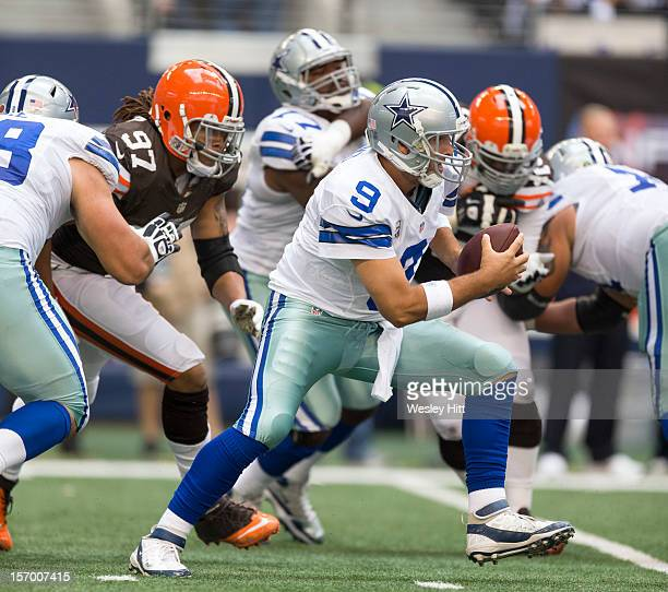 Tony Romo of the Dallas Cowboys scrambles during a game against the Cleveland Browns at Cowboys Stadium on November 18 2012 in Arlington Texas The...