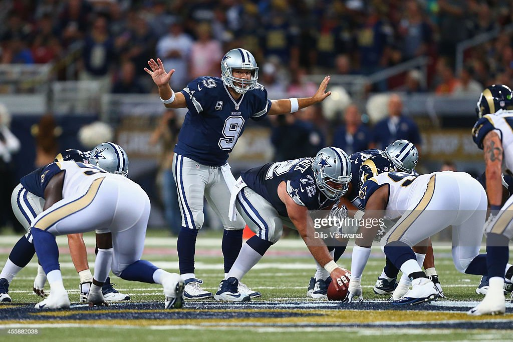 Tony Romo #9 of the Dallas Cowboys singles at the line of scrimmage during the third quarter against the St. Louis Rams at the Edward Jones Dome on September 21, 2014 in St. Louis, Missouri. The Cowboys beat the Rams 34-31.