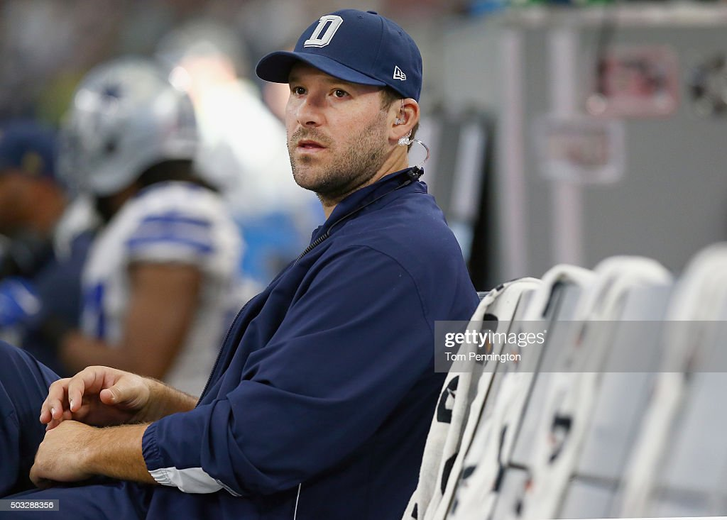 Tony Romo #9 of the Dallas Cowboys sits on the bench late in the fourth quarter as the Washington Redskins beat the Dallas Cowboys 34-23 at AT&T Stadium on January 3, 2016 in Arlington, Texas.