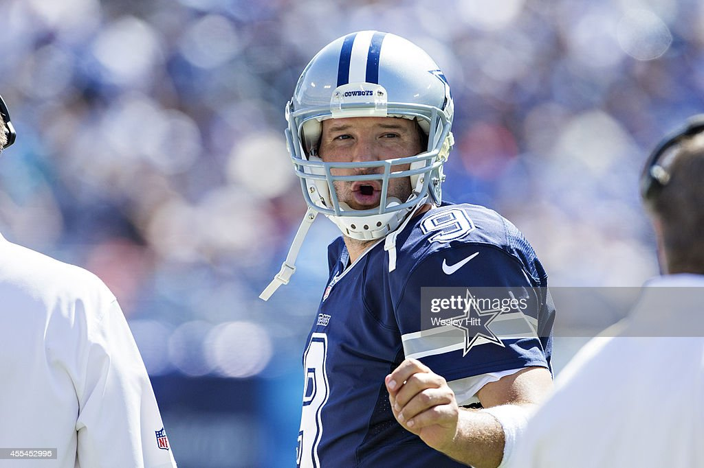Tony Romo #9 of the Dallas Cowboys talks with coaches on the sidelines during a game against the Tennessee Titans at LP Field on September 14, 2014 in Nashville, Tennessee. The Cowboys defeated the Titans 26-10.