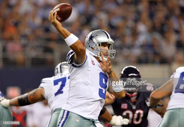 Tony Romo of the Dallas Cowboys throws a pass in the first quarter against the Chicago Bears at Cowboys Stadium on October 1 2012 in Arlington Texas