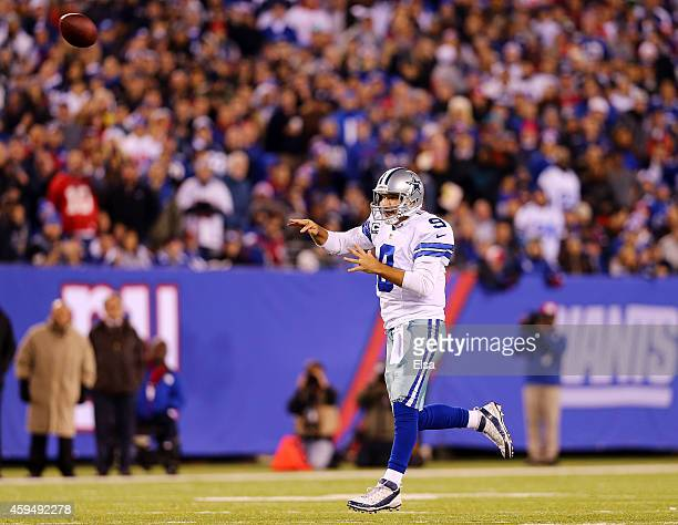 Tony Romo of the Dallas Cowboys throws a touchdown pass to Dez Bryant in the third quarter against the New York Giants at MetLife Stadium on November...
