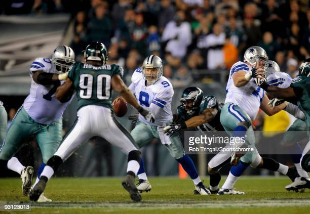 Tony Romo of the Dallas Cowboys tries to escape the rush by Jason Babin of the Philadelphia Eagles at Lincoln Financial Field on November 8 2009 in...