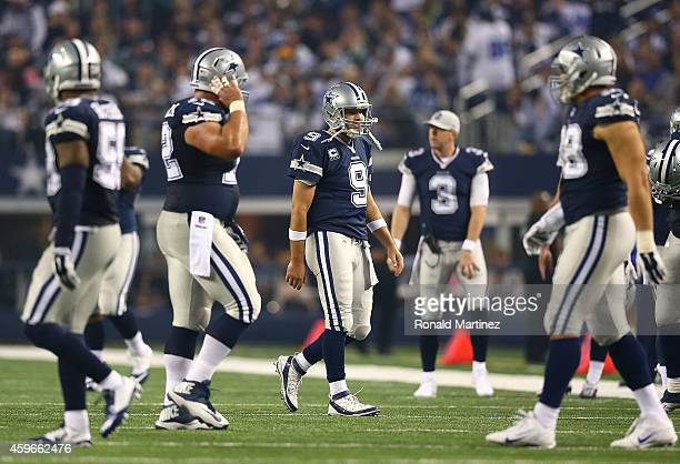 Tony Romo of the Dallas Cowboys walks off the field after failing to pick up a first down against the Philadelphia Eagles in the second half at AT&T...