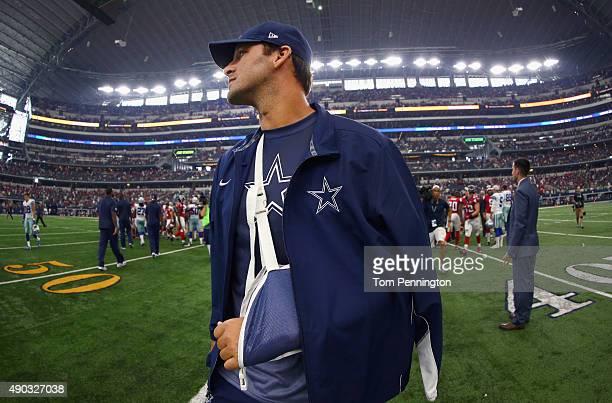Tony Romo of the Dallas Cowboys walks off the field after the Atlanta Falcons beat the Cowboys 3928 at ATT Stadium on September 27 2015 in Arlington...
