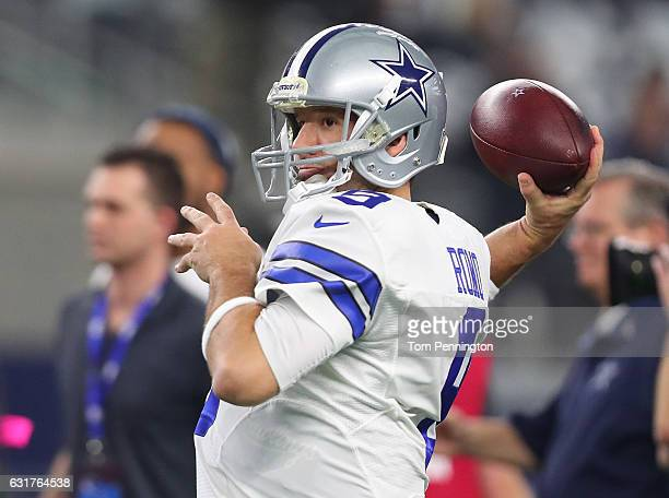 Tony Romo of the Dallas Cowboys warms up on the field prior to the NFC Divisional Playoff game against the Green Bay Packers at ATT Stadium on...