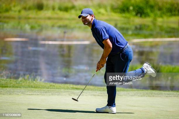 Tony Romo tries to use some body English on his ball while putting on the 6th green during the final round of the American Century Championship at...