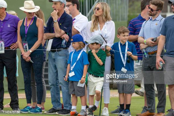 Tony Romos wife Candice Crawford and kids wait for him to tee off during the first round of the ATT Byron Nelson on May 9 2019 at Trinity Forest Golf...