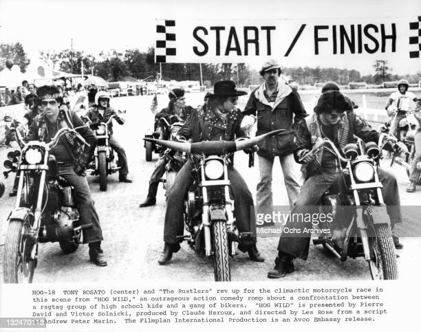 Tony Rosato and The Rustlers rev up for the climactic motorcycle race in a scene from the film 'Hog Wild' 1980