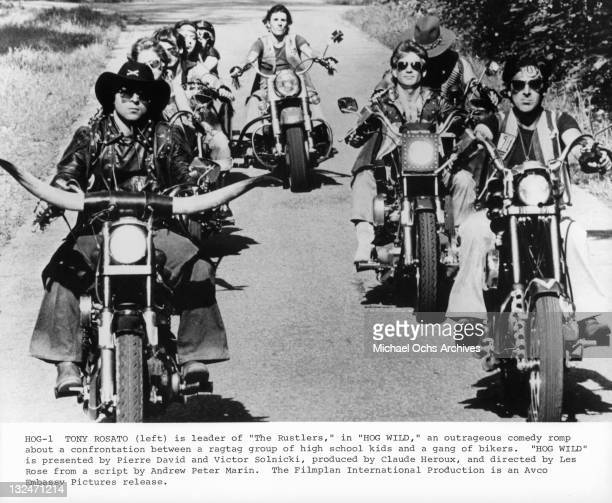 Tony Rosato on HOG with horns leading riders in a scene from the film 'Hog Wild' 1980