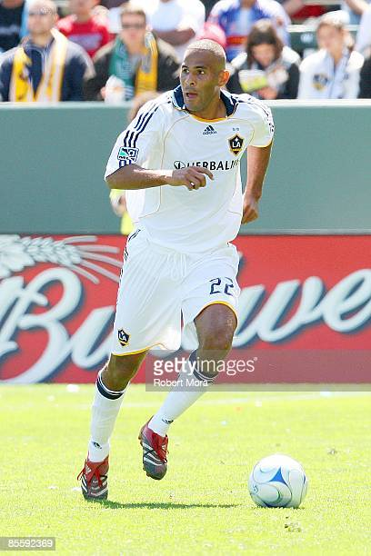 Tony Sanneh of the Los Angeles Galaxy controls the ball against the defense of DC United during the MLS game at Home Depot Center on March 22 2009 in...