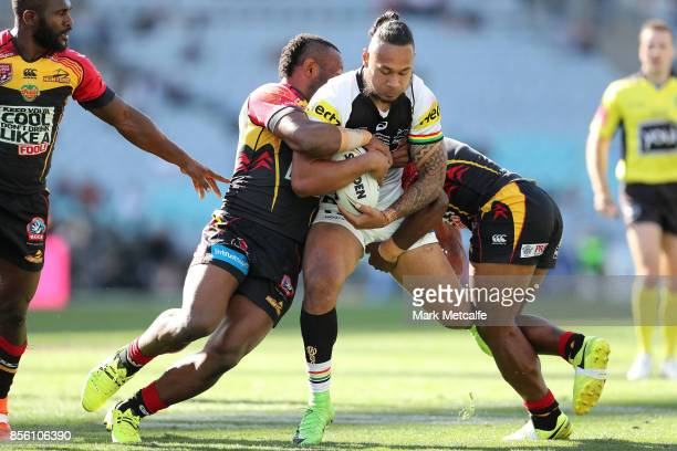 Tony Satini of the Panthers is tackled during the 2017 State Championship Final between the Penrith Panthers and Papua New Guinea Hunters at ANZ...