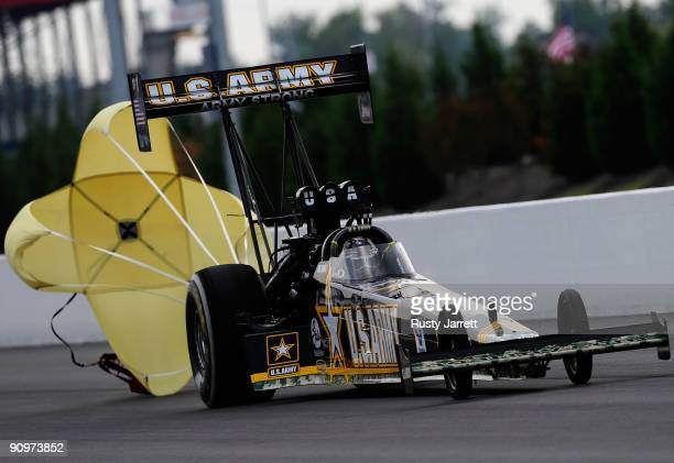 Tony Schmacher driver of the US Army top fuel dragster drives during qualifying for the NHRA Carolinas Nationals on September 19 2009 at Zmax Dragway...