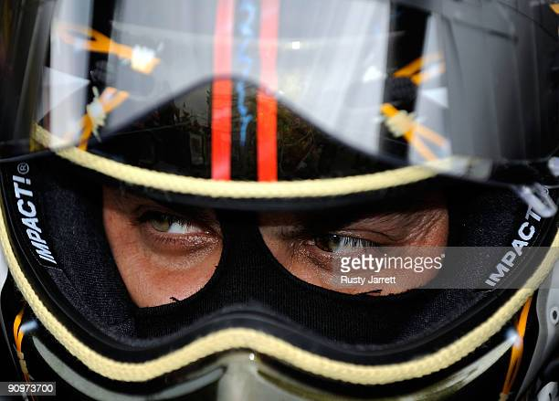 Tony Schmacher driver of the US Army top fuel dragster prepares to drive during qualifying for the NHRA Carolinas Nationals on September 19 2009 at...