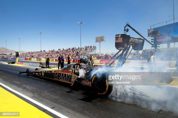 Tony Schumacher Don Schumacher Racing NHRA Top Fuel Dragster does a burnout during the 18th Annual DENSO Spark Plugs NHRA Nationals Mello Yello event...