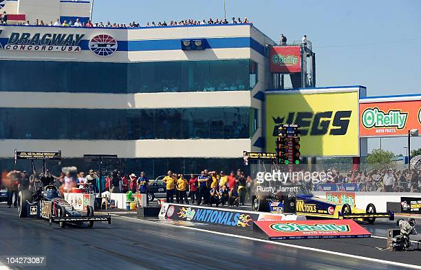 Tony Schumacher driver of the US Army Top Fuel Dragster Doug Herbert driver of the Irwin Tools Top Fuel Dragster during the O'Reilly Auto Parts NHRA...