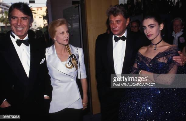 Tony Scotti Syvie Vartan Johnny Hallyday et Adeline Blondieau au Festival de Cannes en mai 1992 France