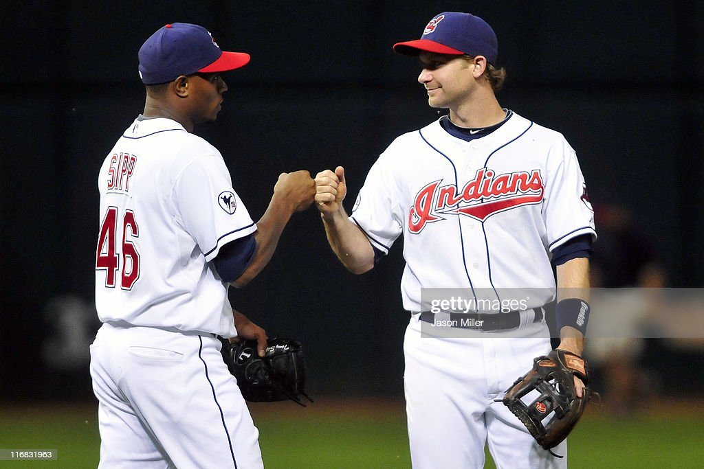 Tony Sipp #46 celebrates with Adam Everett #8 of the Cleveland Indians after the Indians defeated the Pirates 5-1at Progressive Field on June 17, 2011 in Cleveland, Ohio.