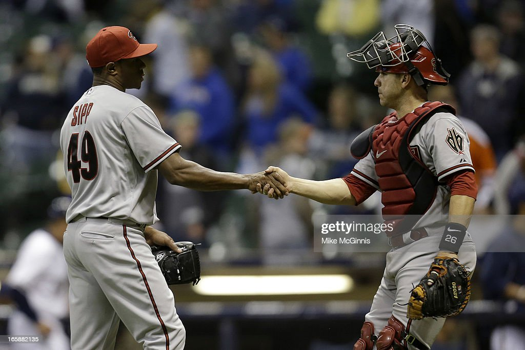 Tony Sipp #49 of the Arizona Diamondbacks celebrates with Miguel Montero #26 after the 9-2 win over the Milwaukee Brewers at Miller Park on April 6, 2013 in Milwaukee, Wisconsin.