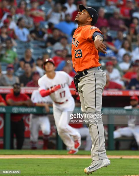 Tony Sipp of the Houston Astros earns a save as he watches Luis Valbuena of the Los Angeles Angels of Anaheim hit an infield fly for the final out in...