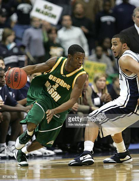 Tony Skinn of the George Mason Patriots drives with the ball against Marcus Williams of the Connecticut Huskies during the Regional Finals of the...