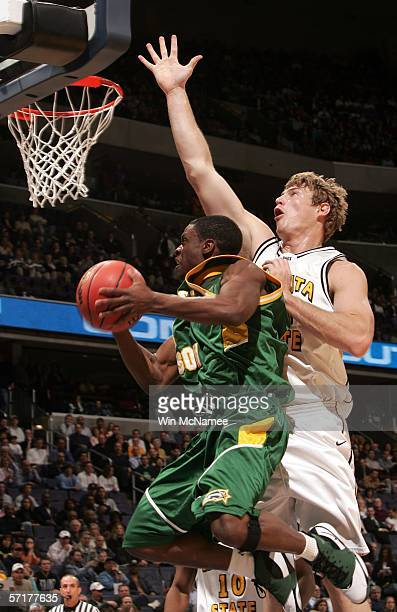 Tony Skinn of the George Mason Patriots puts up a shot against the Wichita State Shockers during the NCAA Division I Men's Basketball Championship...