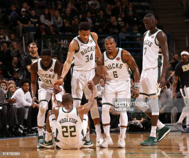 Tony Snell Giannis Antetokounmpo Eric Bledsoe helps us Khris Middleton of the Milwaukee Bucks during the game against the Denver Nuggets on February...