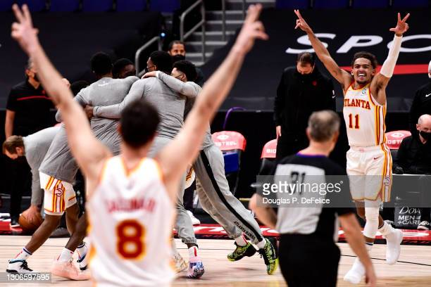 Tony Snell of the Atlanta Hawks celebrates with teammates after shooting a three pointer for the win at the buzzer to beat the Toronto Raptors by a...