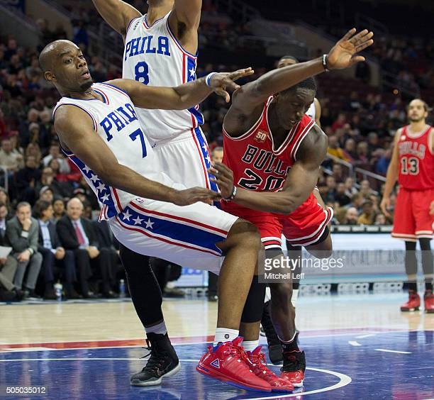 Tony Snell of the Chicago Bulls charges into Carl Landry of the Philadelphia 76ers on January 14 2016 at the Wells Fargo Center in Philadelphia...