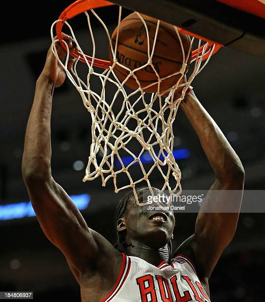 Tony Snell of the Chicago Bulls dunks the ball against the Detroit Pistons during a preseason game at the United Center on October 16 2013 in Chicago...