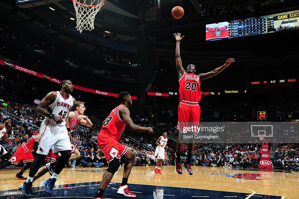 Tony Snell #20 of the Chicago Bulls reaches for a rebound against the Atlanta Hawks on February 25, 2014 at Philips Arena in Atlanta, Georgia.