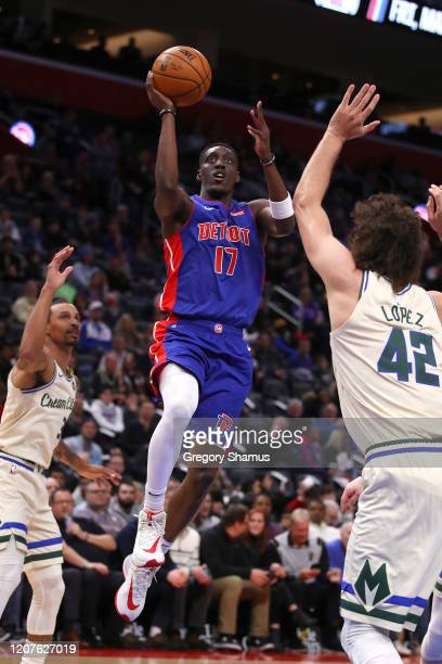 Tony Snell of the Detroit Pistons tries to get a shot off past Robin Lopez of the Milwaukee Bucks during the first half at Little Caesars Arena on...