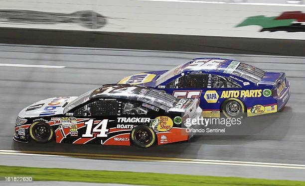 Tony Stewart and Martin Truex Jr during the Sprint Unlimited NASCAR Sprint Cup race at Daytona International Speedway on Saturday February 16 in...