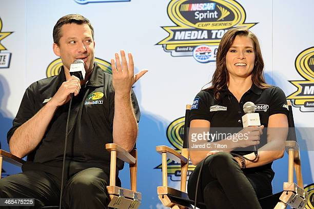 Tony Stewart coowner of StewartHaas Racing and driver of the Bass Pro Shops Chevrolet and Danica Patrick driver of the GoDaddycom Chevrolet speak...