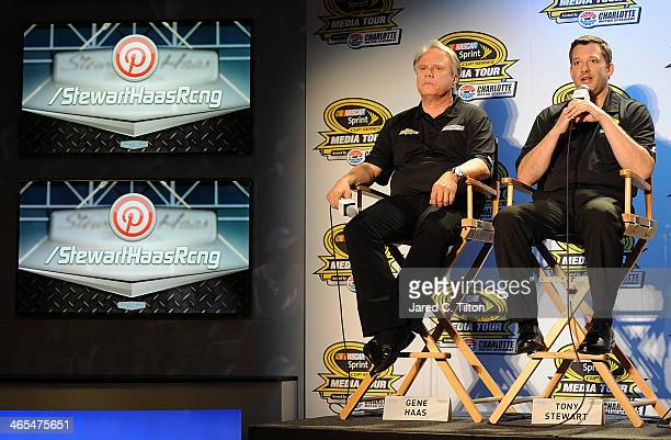 Tony Stewart coowner of StewartHaas Racing and driver of the Bass Pro Shops Chevrolet and Gene Haas coowner of StewartHaas Racing speak with the...
